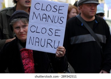 BRISBANE, AUSTRALIA - JUNE 20: Street marcher with sign calling for closure of Nauru and Manus island detention center during World Refugee day