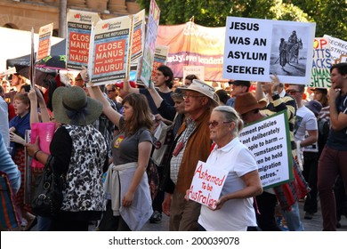 BRISBANE, AUSTRALIA - JUNE 22 : Anti government  immigration policy protesters marching streets during World Refugee Rally June 22, 2014 in Brisbane, Australia