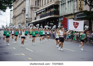 BRISBANE, AUSTRALIA - MAR 12: Cheerleaders of John Paul College perform to celebrate St Patrick's day on Mar 12, 2011 at the Elizabeth st, Brisbane, Australia.