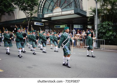 BRISBANE, AUSTRALIA - MAR 12: Men wearing kilts perform to celebrate St Patrick's day on Mar 12, 2011 at the Elizabeth st, Brisbane, Australia.