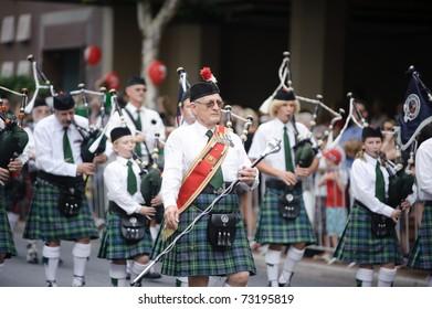 BRISBANE, AUSTRALIA - MAR 12: An unidentified old man in a kilt performs to celebrate St Patrick's day on Mar 12, 2011 at the Elizabeth st, Brisbane, Australia.