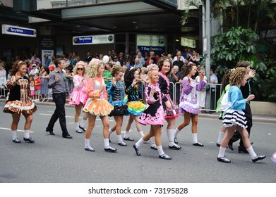 BRISBANE, AUSTRALIA - MAR 12: Unidentified children wearing irish traditional dresses parade to celebrate St Patrick's day on Mar 12, 2011 at the Elizabeth st, Brisbane, Australia.