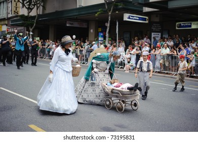 BRISBANE, AUSTRALIA - MAR 12: Unidentified children and women dressed as traditional Irish people perform to celebrate St Patrick's day on Mar 12, 2011 at the Elizabeth st, Brisbane, Australia.