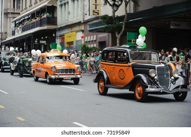 BRISBANE, AUSTRALIA - MAR 12: Various classic cars march to celebrate St Patrick's day on Mar 12, 2011 at the Elizabeth st, Brisbane, Australia.