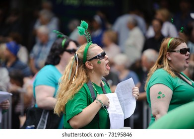 BRISBANE, AUSTRALIA - MAR 12: An woman dressed green from head to foot performs to celebrate St Patrick's day on Mar 12, 2011 at the Elizabeth st, Brisbane, Australia.