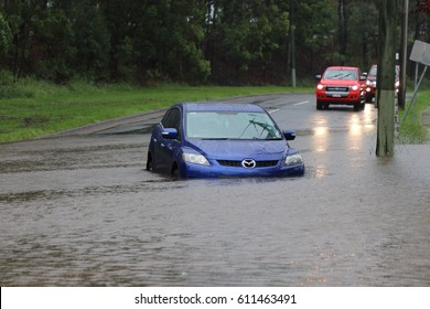 BRISBANE, AUSTRALIA - March 30, 2017: Car stuck in floodwater in the suburb of Rocklea from huge rainfall as a result of Tropical Cyclone Debbie.