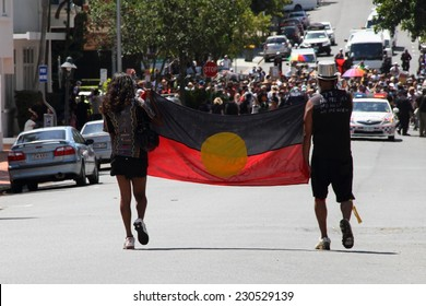 BRISBANE, AUSTRALIA - NOVEMBER 14 : Unidentified protestors  carrying flag to marchers in Musgrave Park gate opening ceremony at g20 aboriginal protest on November 14, 2014 in Brisbane, Australia