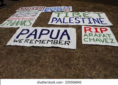 BRISBANE, AUSTRALIA - NOVEMBER 15: Protest banners at g20 rally on November 15, 2014 in Brisbane, Australia
