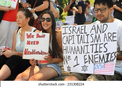 BRISBANE, AUSTRALIA - NOVEMBER 15: Unidentified protestor with anti Israel and capitalism g20 protest sign on November 15, 2014 in Brisbane, Australia
