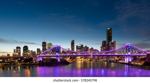 BRISBANE, AUSTRALIA - NOVEMBER 19. 2016: The Story Bridage with with purple lights and downtown Brisbane in Australia.