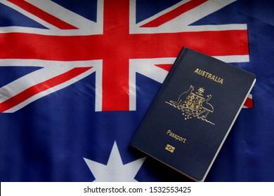 Brisbane, Australia - October 16 2019: Australian Passport set against the backdrop of the Australian national flag