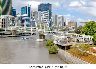 Brisbane, Australia - October 4, 2009: A CityCat travels under Kurilpa Bridge