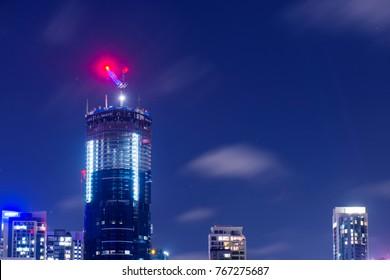 Brisbane, Australia - Saturday 25th November, 2017: View of Brisbane City skyscrapers at night with clouds on Saturday 25th November 2017.