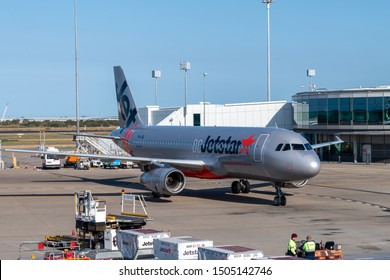 Brisbane, Australia - Sept 15 2019: Jetstar Airbus A320 airliner taxiing to terminal gate on tarmac at Brisbane airport plane ready for unloading and loading of cargo and luggage