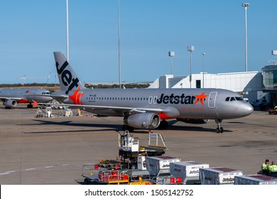 Brisbane, Australia - Sept 15 2019: Side view of Jetstar Airbus A320 airliner taxiing to terminal gate on tarmac at Brisbane airport plane ready for unloading and loading of cargo and luggage