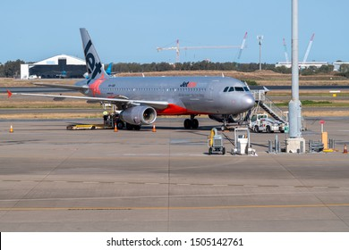 Brisbane, Australia - Sept 15 2019: Jetstar Airbus A320 airliner refuelling on tarmac at Brisbane airport with front stairs in place ready for boarding