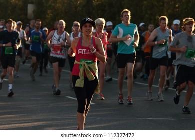 BRISBANE, AUSTRALIA - SEPTEMBER 02 : Unidentified runners  participating in the 'Bridge to Brisbane'� charity fun run on September 02, 2012 in Brisbane, Australia.