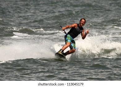 BRISBANE, AUSTRALIA - SEPTEMBER 15 :  World champion Cory Teunissen giving wakeboarding demonstration as part of Australian Water Ski Racing Championship on September 15, 2012 in Brisbane, Australia