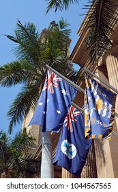 Brisbane, Australia - September 19, 2017: Flags Outside Brisbane's City Hall: Australian National Flag, Queensland State Flag & Brisbane City Flag.