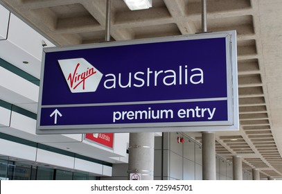 BRISBANE, AUSTRALIA – SEPTEMBER 2 2015: Virgin Australia logo with Premium Entry signage on display outside Brisbane Airport's domestic terminal in the departures area.