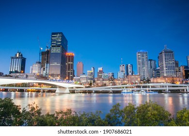 Brisbane, Australia - September 7 2008: Brisbane skyline from Southbank and Victoria Bridge during rush hour at dusk.