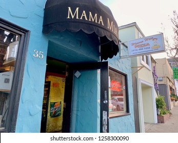 Brisbane, California USA / December 12, 2018: exterior Mama Mia restaurant, blue walls, black awning, further businesses in background