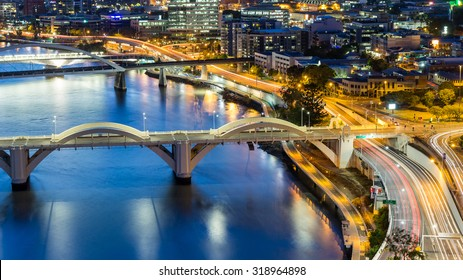 Brisbane City, Australia, Beautiful Panorama Aerial View of William Jolly Bridge and Merivale Bridge over Brisbane River with Brisbane Cityscape and Light Trails at Sunset in Summer, Queensland