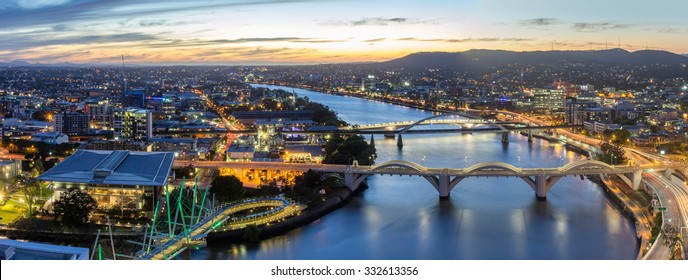Brisbane City, Beautiful Panorama Aerial View of Kurilpa Bridge, William Jolly Bridge and Merivale Bridge over Brisbane River Cityscape, GOMA and Light Trails at Summer Sunset, Queensland, Australia
