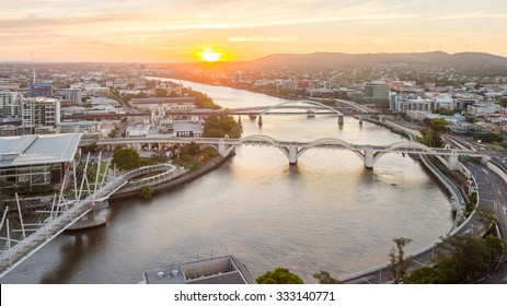 Brisbane City, Beautiful Panorama Aerial View of Kurilpa Bridge, William Jolly Bridge and Merivale Bridge over Brisbane River with Cityscape under Golden Sky at Sunset in Summer, Queensland, Australia