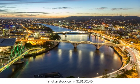 Brisbane City, Panorama Aerial Sunset View of Kurilpa Bridge, William Jolly Bridge and Merivale Bridge over Brisbane River with Cityscape Skyline at Twilight Dusk in Summer, Queensland, Australia