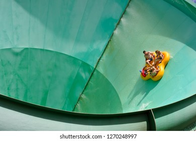 BRISBANE - DEC 28 2018:People ride on a water slide named Green Room in White Water World, Gold Coast, Australia