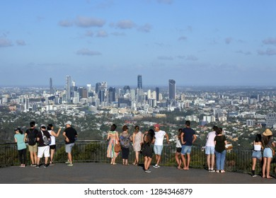 BRISBANE - JAN 13 2019:People looking at  panoramic landscape view of Brisbane city from Mt Coot-Tha lookout in Queensland, Australia.