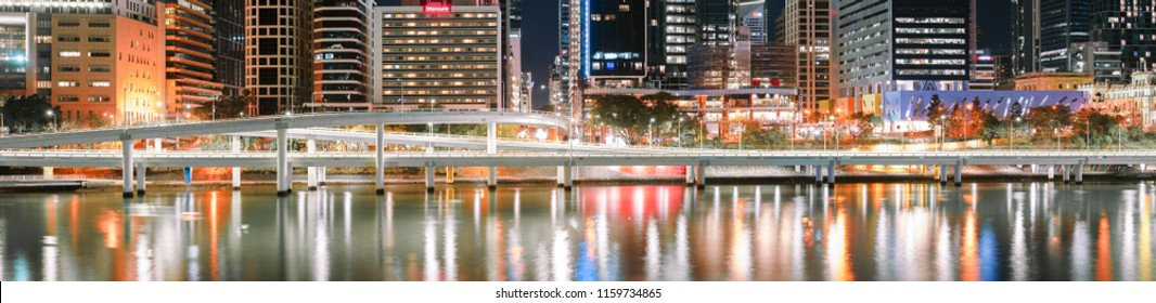 BRISBANE, QUEENSLAND, AUSTRALIA - AUGUST 18th 2018: Brisbane city skyscrapers, river and freeway at night on Saturday 18th August 2018.
