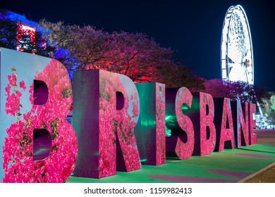 BRISBANE, QUEENSLAND, AUSTRALIA - AUGUST 19th 2018: View of the Brisbane sign and wheel at Southank, Brisbane city, Queensland at night on Sunday 19th August 2018.