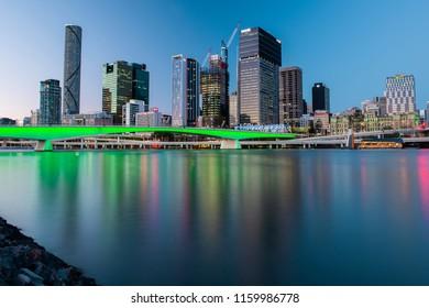 BRISBANE, QUEENSLAND, AUSTRALIA - AUGUST 19th 2018: View of Victoria bridge and river in Brisbane city, Queensland at dusk on Sunday 19th August 2018.