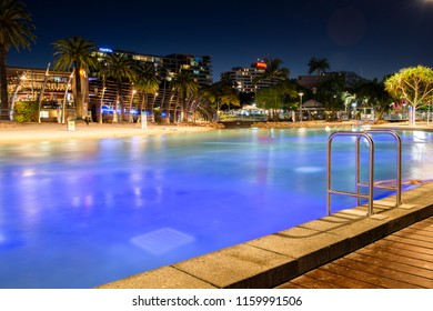BRISBANE, QUEENSLAND, AUSTRALIA - AUGUST 19th 2018: View of the public pool at Southank, Brisbane city, Queensland at night on Sunday 19th August 2018.