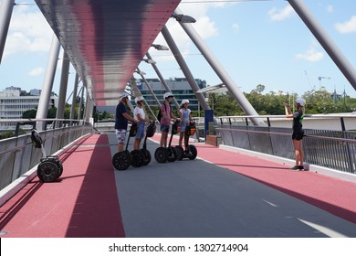 Brisbane, Queensland / Australia - December 28 2018: A Segway tour group at the Goodwill Bridge along the Brisbane River