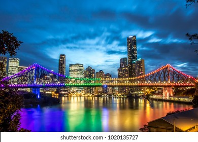 Brisbane, Queensland / Australia - January 23 2018: Story Bridge lit up in rainbow colours reflecting on the Brisbane river