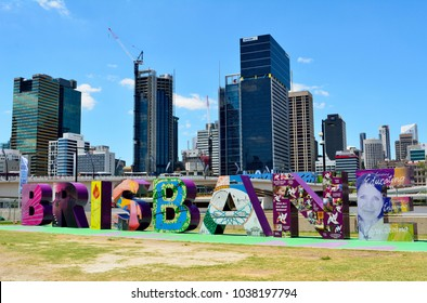 Brisbane, Queensland, Australia - January 6, 2018. Letters making Brisbane sign in South Bank Parklands, with modern buildings in the background.