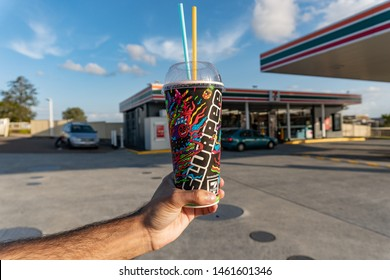 Brisbane, Queensland / Australia - July 26th 2019: Cherry Slurpee close up from Seven Eleven(7-Eleven) with two straws