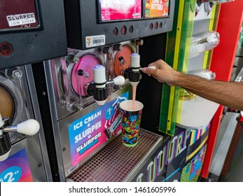 Brisbane, Queensland / Australia - July 26th 2019: Cherry Slurpee from a dispenser in Seven Eleven(7-Eleven)