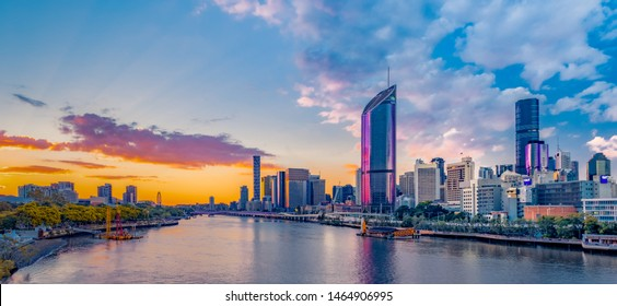 BRISBANE, QUEENSLAND / AUSTRALIA - July 6 2019: Panoramic photo of Brisbane overlooking South Bank Parklands, the Brisbane River, and the city skyline with a spectacular sunset