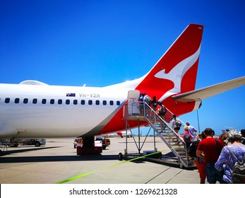 Brisbane, Queensland, Australia - On December 29 , 2018. - People boarding a Qantas domestic airline Aircraft Type: Boeing 737 on the runway.