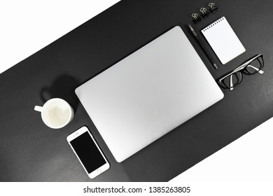 Brisbane, Queensland/Australia - April 23 2019: Top down view of a desk flat lay with laptop closed. Minimal design, clean and modern, black, white and grey theme