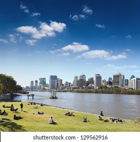 brisbane skyline from the park and people in lawn , queensland, Australia