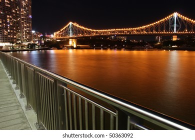 Brisbane's iconic Story Bridge and the city's famous riverside walkway.