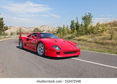 "BRISIGHELLA, RA, ITALY  - AUGUST 31: unidentified driver on a italian sports car Ferrari F40 at rally ""Trofeo Lorenzo Bandini"" on August 31, 2013 in Brisighella, RA, Italy"