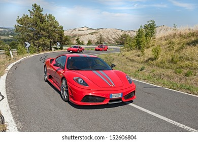 "BRISIGHELLA, RA, ITALY  - AUGUST 31: unidentified driver on a italian sports car Ferrari 430 Scuderia at rally ""Trofeo Lorenzo Bandini"" on August 31, 2013 in Brisighella, RA, Italy"