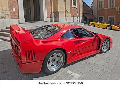 "BRISIGHELLA, RA, ITALY  - AUGUST 31: italian sports car Ferrari F40 parked during the rally ""Trofeo Lorenzo Bandini"" on August 31, 2013 in Brisighella, RA, Italy"