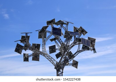 Bristol, England, 03/25/2019 Millennium Square solar power tree. The Energy Tree,  with multi-directional solar panels designed by artist John Packer and Bristol-based Demand Energy Equality.